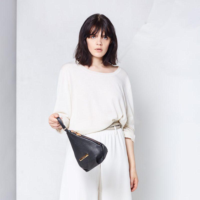 black wristlet pouch sustainable designer bag